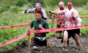 A runner tries to escape with his life as zombies pursue him during the Run for Your Lives race. The5K course is littered with obstacles -- and the undead