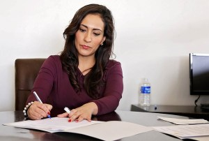 woman writing in office