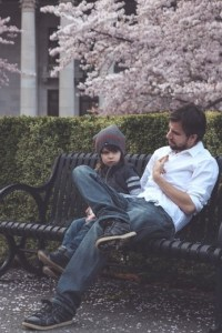 father and son on bench