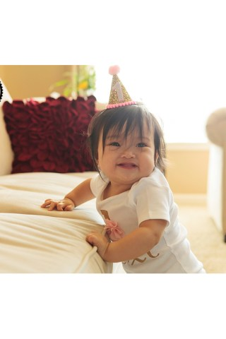 Sweet photos in home of a baby girl's first birthday. Portraits by Adored by Meghan