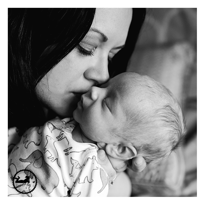 A momma with her new baby boy. Photographer: Adored by Meghan, Kennewick, WA.  Lifestyle and newborn family portrait photographer.