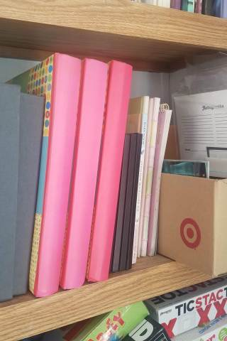 Printed albums on a shelf.
