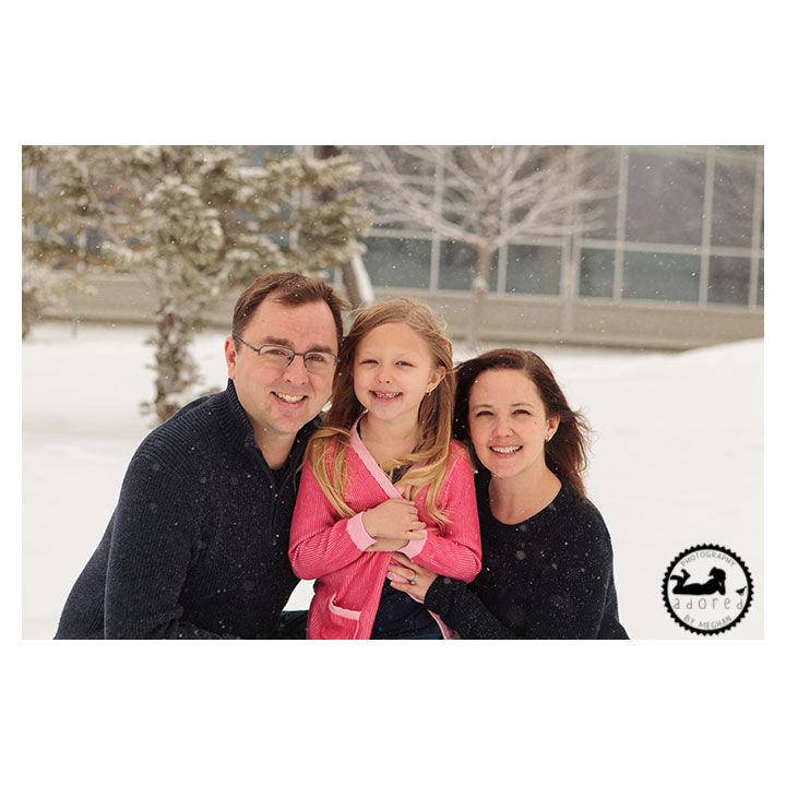 Family photos during winter mini-sessions in the snow. Kennewick library. Photographer: Adored by Meghan.