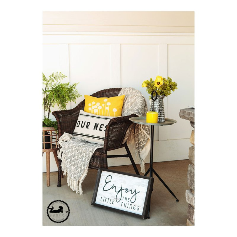 Front porch chair with pillows and side table, yellow and black theme