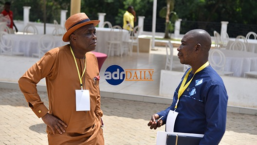 Mr Austin Gamey(left) and Prof. William Baah-Boateng in a chat at the event