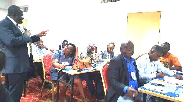 Justice Sir Dennis Adjei interacting with the participants at the session