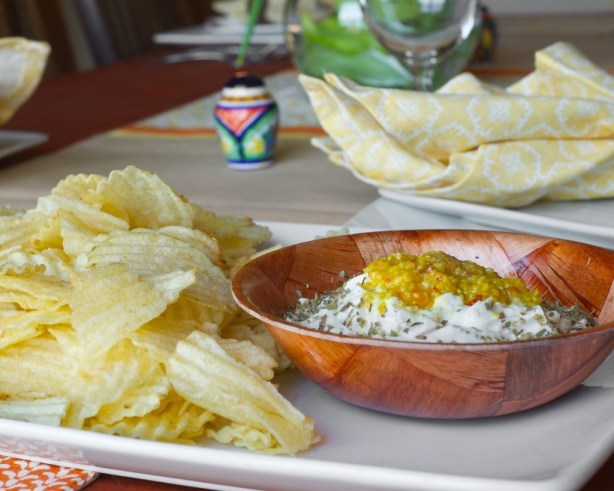 yogurt dip with species and garlic served with potato chips