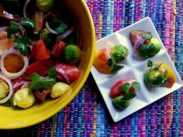 Heirloom Tomato and Avocado Salad is a seasonal and fresh option to start the fall.