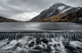 The Weir at the end of Ogwen Lake, Snowdonia with Tryfan mountain in the background, North Wales, UK.