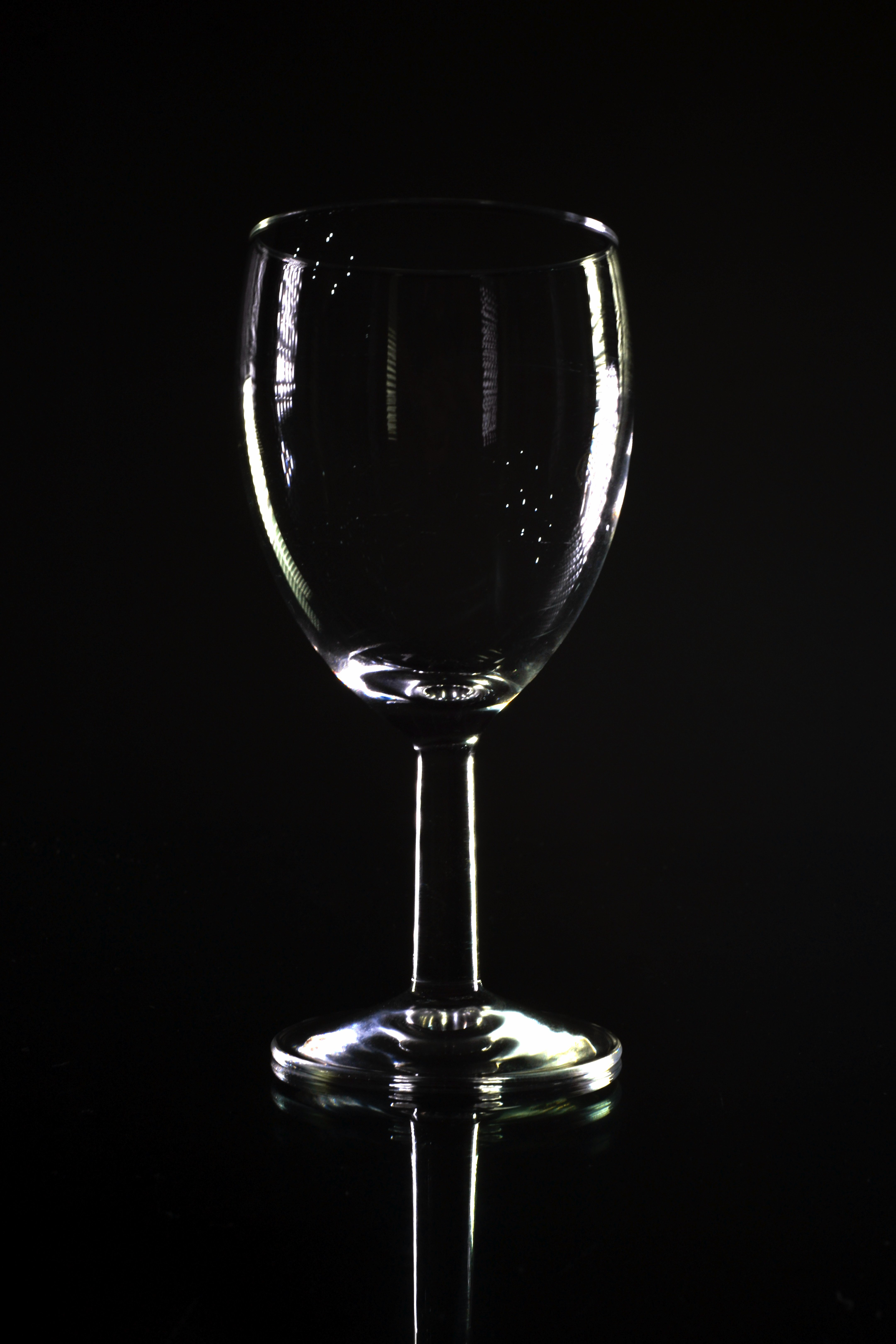 Stock Photo of Empty Wine Glass Shape Outlined with Black Background