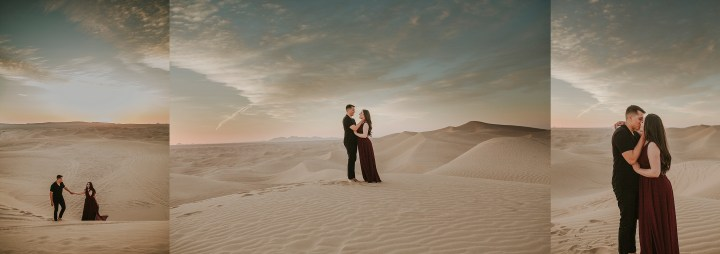 couple embraving in sand dunes