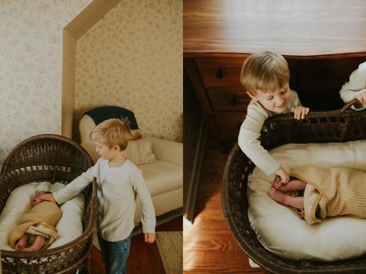 big brothers near baby basket