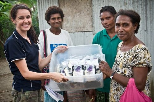 bloggers for birth kits volunteer handing out birth kits in papua new guinea