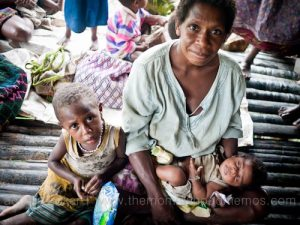 Mother, baby, and toddler. Giving birth in the Bamu River region, Western Province, PNG.