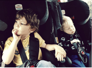 Two toddlers in carseats