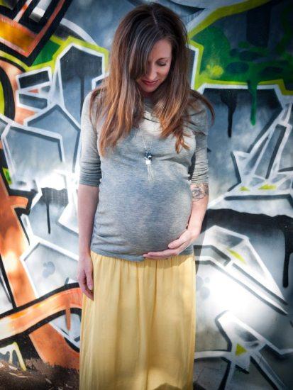 Ryan Adriel Booker 38 weeks pregnant rainbow baby belly graffiti