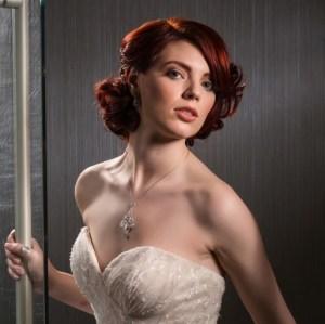 Bride wearing glamour make up in doorway.