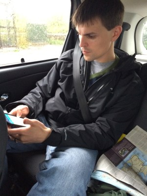 Mark consulting his GPS and comparing it to the maps.