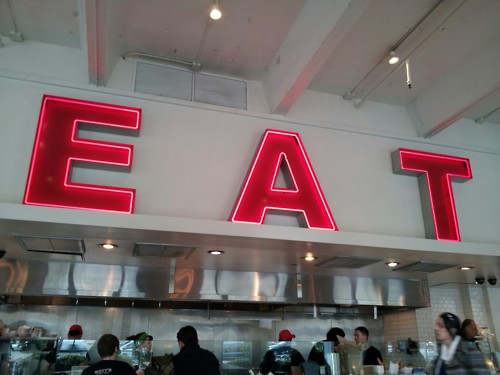 Eating at the EAT sign!