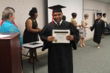 A Project SEARCH Montgomery graduate displays his certificate