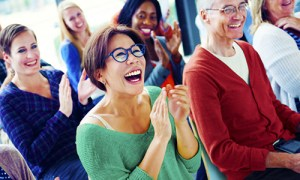 People-laughing-during-a-keynote-speech-5e22567cae782c46110cae9fc1585d9a7fb226f8