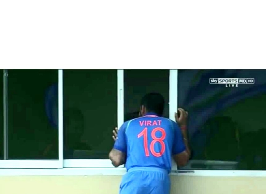Virat trying to see inside the window