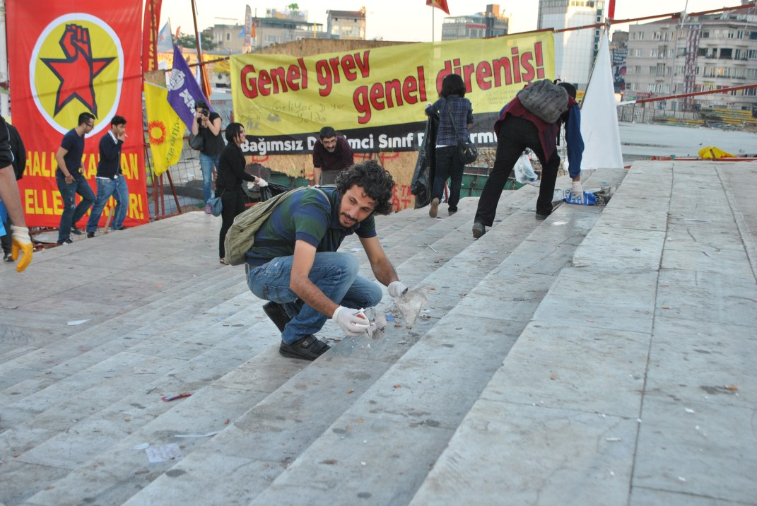 Protesters clean the stairs in the entrance of Gezi Park from Taksim Square.