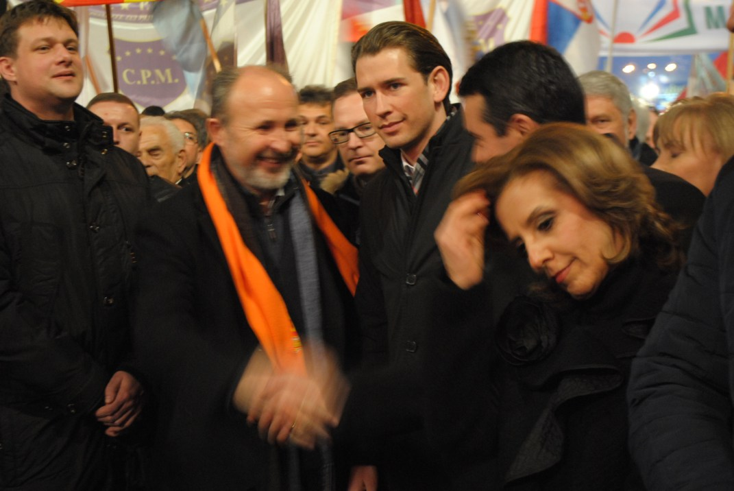 Mayor of Skopje, Koce Trajanovski greets Nikola Poposki before the beginning of the rally on November 27, 2016. Sebastian Kurz was a guest to the meeting (M). Current Minister of Culture, Elizabeta Kanceska-Milevska will run together with Poposki in the Electoral Unit 1 for the early elections on December 11.
