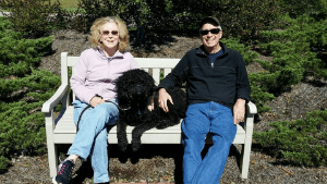 Adult ADHD Unplugged Marge, Bruce, and their dog Happy sitting on a bench