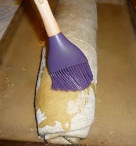 Brushing Melted Earth Balance over Bread Roll
