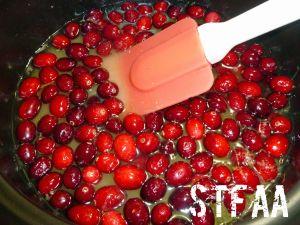 Cranberries, sugar, lemon zest and water in a sauce pot