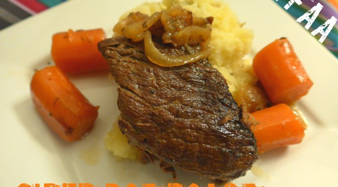 Cider Pot Roast plated with carrots, onions, and mashed potatoes