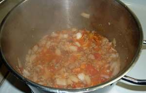 Ground pork, onions and tomato mixture after tomatoes have cooked to sauce