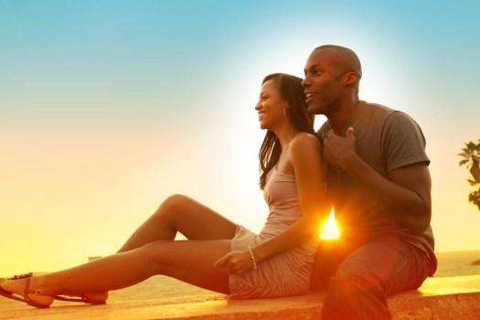 sunset holidaying couple