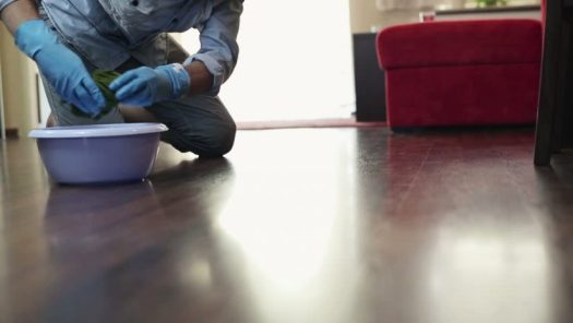 Man Sad Cleaning Floor