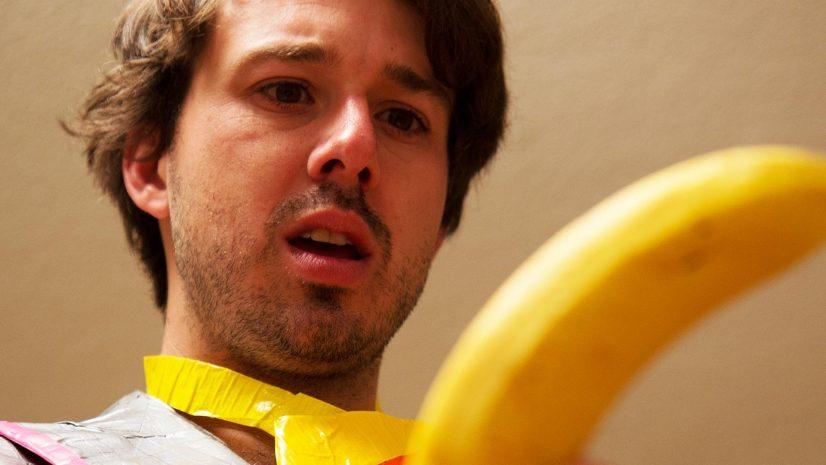Man Looking at Banana