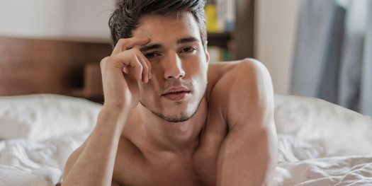 Shirtless Man on Bed