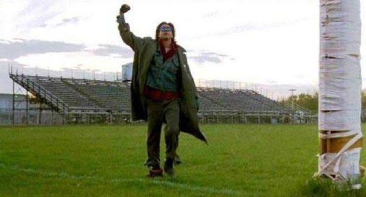 Man Fist Pumping on Grass Field Photo