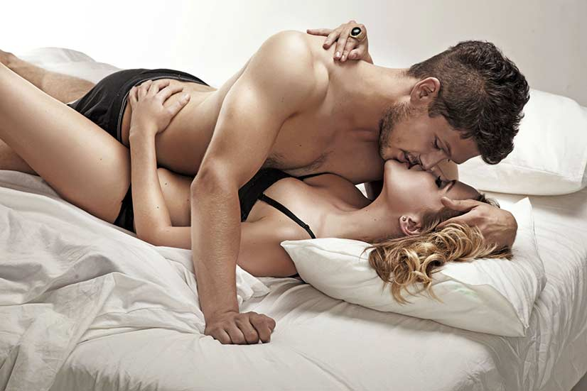 Happy Couple In Bed Photo