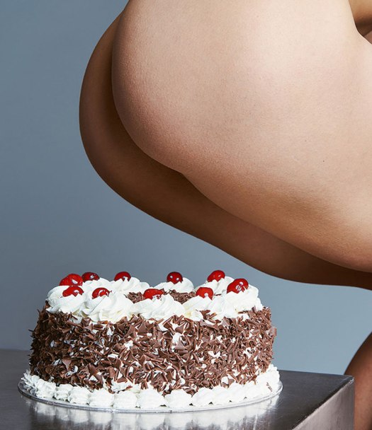 A Person Sitting On A Cake