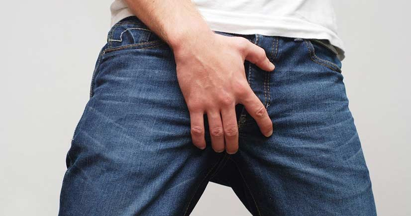 Man In Blue Jeans Holding His Crotch