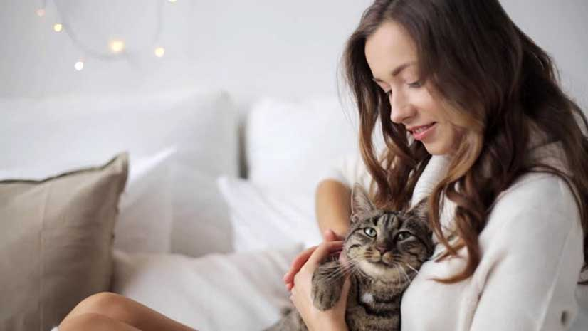 Woman Happy At Home With Pet