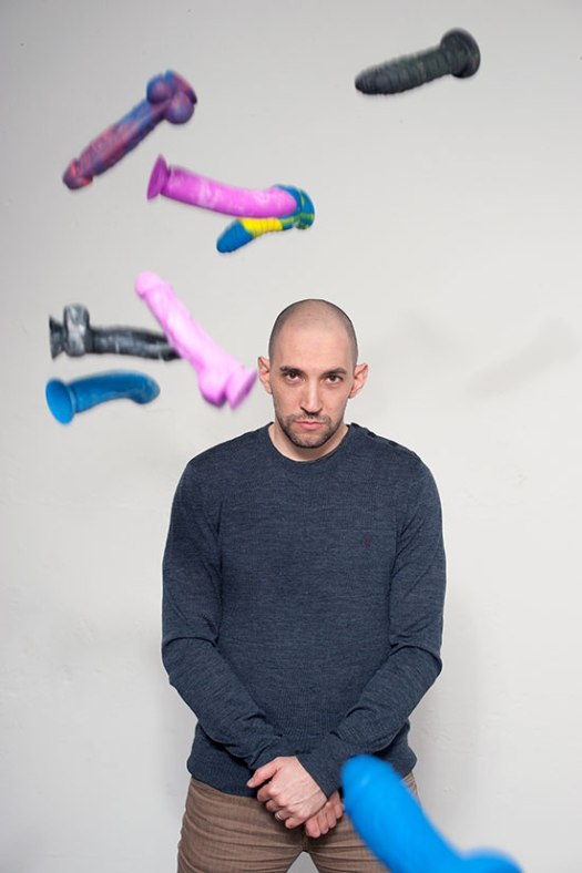 Brian Sloan with multicoloured dildos