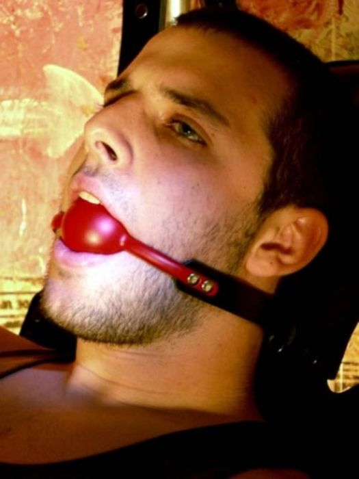 Naked Man Using BDSM Ball Gag In Mouth