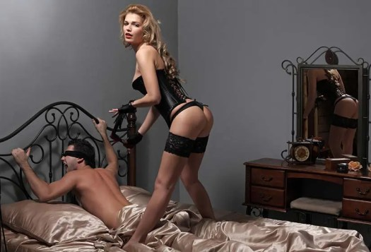 Dominatrix with a submissive man
