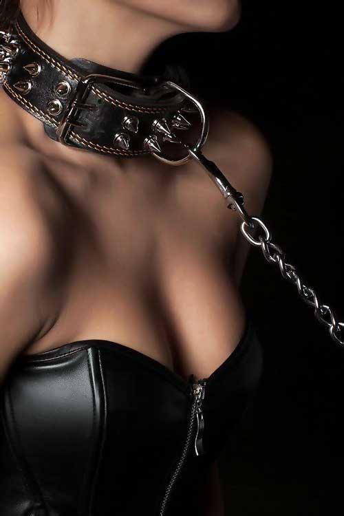Woman in black bondage gear