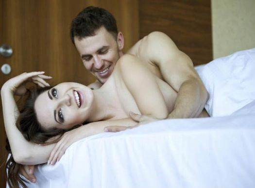 Happy woman being spooned