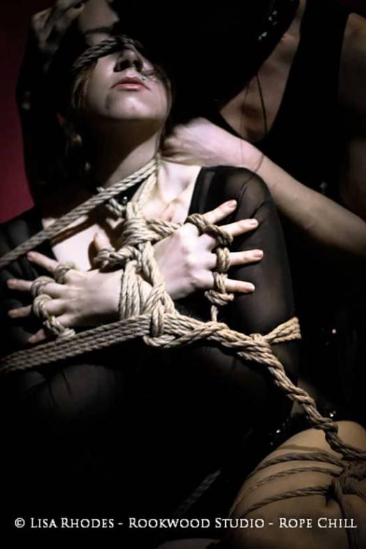 Escort in bondage ropes