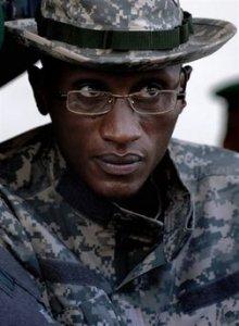 Congo's Nkunda arrested in Rwanda, faces extradition