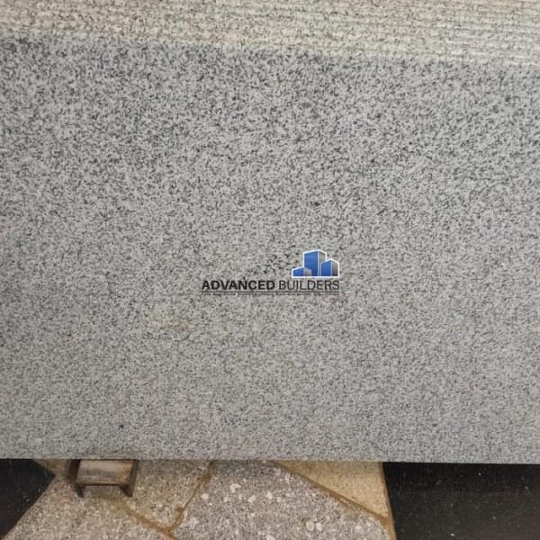 Advanced Builders White and Black Granite